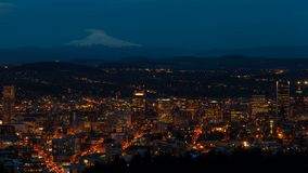 Tme lapse of auto traffic and light trails with Mt. Hood and city of Portland Oregon stock video