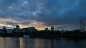 Tme lapse of clouds along Willamette River waterfront in downtown Portland OR 4k stock footage