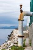 Tömning av kloak in i havet Royaltyfria Foton
