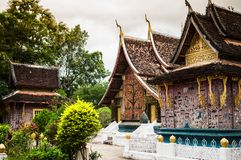 TMural art of Wat Xieng thong, Luang Prabang, Laos stock photos