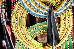 Tnational african handmade decorations and tribal spear. Tnational african handmade colorful decorations and tribal spear on Zanzibar market stock photos