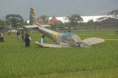 TNI INDONESIAN MILITARY RESTRUCTURING PLAN. A crash-landed Indonesian Air Force's trainer aircraft AS-202 Bravo at Sukoharjo, Java, Indonesia. The Indonesian Royalty Free Stock Photos