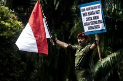 TNI INDONESIAN MILITARY RESTRUCTURING PLAN. A nationalism campaign by army soldier Partika Subagyo at Solo, Java, Indonesia. The Indonesian government is Stock Photos