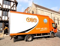 TNT delivery. Lincoln, UK - April 9, 2015: TNT truck delivery in city centre of Lincoln, Lincolnshire, England. TNT is a famous international courier delivery Royalty Free Stock Images
