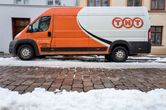TNT Express delivery van on a partly snow covered street Royalty Free Stock Photos