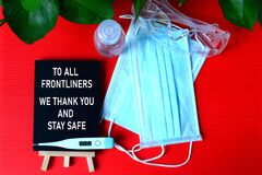 Gratitude to frontliners concept with red background of personal protective equipment