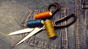 To alter jeans. Sew your own hands.To change the lock stock images
