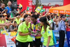 To assist athletes into the lounge area. To assist the champion athletes into the lounge area.Half international marathon in fushui county in yunnan province in Royalty Free Stock Images