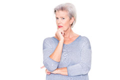 To be amazed about something. Senior woman ist amazed about something in front of white background Royalty Free Stock Photo