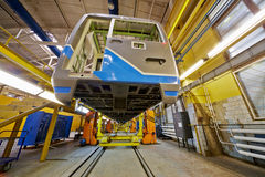 To-be assembled wagon on jacks in shop floor Royalty Free Stock Image