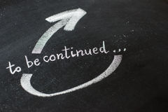 To be continued handwritten with white chalk Royalty Free Stock Photos