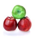 To be different green apple betwen red ones Stock Images