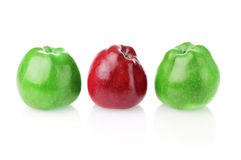 To be different one. Different bright red apple between two green apples on white background Stock Images