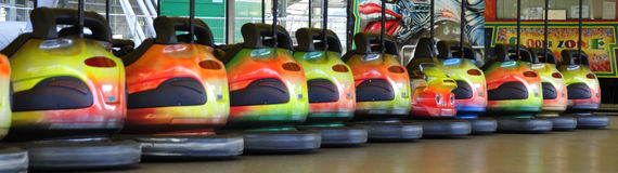 To be different. Quite a lot of bumper cars in a line - but one is different stock photography