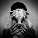 To be an elephant. Girl with a soft toy elephant Stock Photo