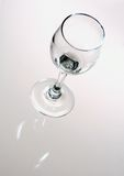 To be filled. A single wine glass on a white and grey background Royalty Free Stock Image