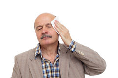 To be ill during the heat. Elderly and the sick man wipes the sweat from his forehead Stock Images