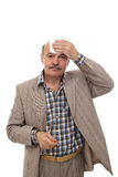To be ill during the heat. Elderly and the sick man wipes the sweat from his forehead Stock Image