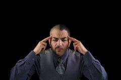 To be or not to be. A man holding his head by his fingers, presenting stress and pain Royalty Free Stock Photography