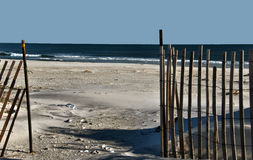 To The Beach. Snow fence opening to a wide open empty beach Royalty Free Stock Photos