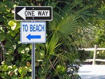 To beach sign. One way to public beach sign pole Stock Photos