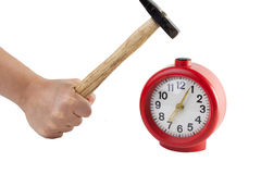 To beat his fist on the red alarm clock Royalty Free Stock Photo