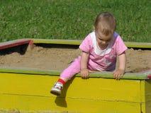 To the big world. Baby on sandbox Stock Photography