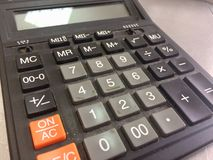 Electronic calculator. To calculate costs and sales royalty free stock images