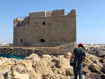 To the castle. A man walking towards the castle in Paphos, Cyprus stock photos
