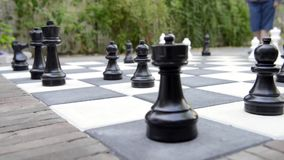 To castle on the king's side in outdoor chess stock video footage