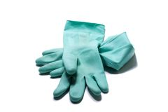 To clean. A pair of blue rubber cleaning gloves isolated on a white background Royalty Free Stock Images
