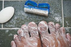 To clean the foot with a brush and soap. Royalty Free Stock Photography