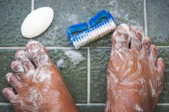 To clean the foot with a brush and soap. Stock Image