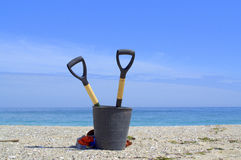 Lets clean the Еarth-tools on empty beach Royalty Free Stock Photography