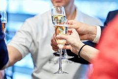To clink wine glasses with champagne stock image