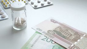 To count money. Pay for medicament drugs. People Buying drugs. Medicine pills or capsules with money on white background stock video