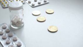 To count money. Pay for medicament drugs. People Buying drugs. Medicine pills or capsules with money on white background stock video footage