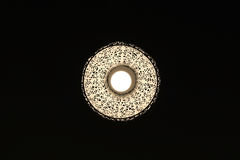 In to the Dark a lamp with nice patter Royalty Free Stock Photo