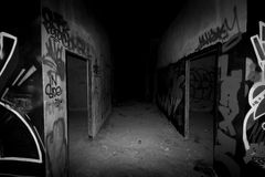To the darkness. Abandoned building on black and white Royalty Free Stock Image