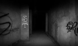 To the darkness. Abandoned building on black and white Royalty Free Stock Photography