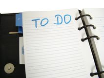 To Do. Black leathered organizer opened at to do page Royalty Free Stock Images