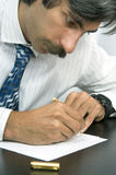 To Do List. A businessman writing to do list Stock Photo