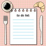 To-do-list on the table with coffee, croissant, fork and knife royalty free illustration
