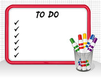 To Do List. Copy space to create your own to do list on this red frame dry erase white board with check marks, 5 multicolor felt marker pens on grid background Stock Image