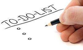 To-do-list. Person writing a to do list. All on white background Stock Images