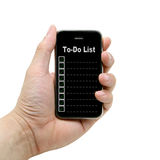 To Do List. Hand hold smart mobile phone with blank to do list Royalty Free Stock Images