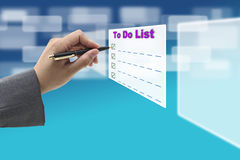 To Do List. Businessman hand Writing To Do List on Technology Virtual Whiteboard Interface stock photo