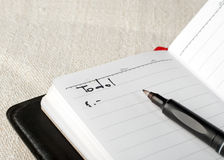 To do list. Close up of open netbook and pen Royalty Free Stock Images