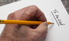 To Do List. Close up of a person writing a to do list Royalty Free Stock Image