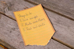 To do list. Lose weight,make more money,find soul mate on a wood picnic table Royalty Free Stock Photos